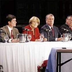 From left, gubernatorial candidates, independent Shawn Moody, independent Kevin Scott, Democrat Libby Mitchell, independent Eliot Cutler and Republican Paul LePage listen to a question during a debate hosted by the Maine State Chamber of Commerce Wednesday Oct. 20, 2010 in Portland, Maine. (AP Photo/Joel Page)