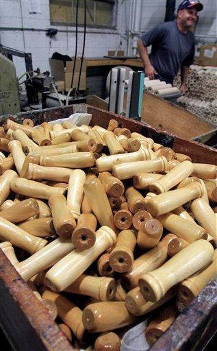 In this Sept. 28, 2010 photo, hundreds of rolling pin handles are seen at the recently reopened Saunders Brothers manufacturing plant in Greenwood, Maine. Investor, Louise Jonaitis has bought 4 mills in areas of interior Maine saying that she intends to bring the plants back to life and provide work opportunities in regions where jobs are scarce. Worker Scott Allen is assembling rolling pins in the background. (AP Photo/Pat Wellenbach)