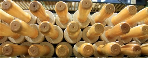 In this Tuesday, Sept. 28, 2010 photo, rows of rolling pins are seen at the recently reopened Saunders Brothers manufacturing plant in Greenwood, Maine. Investor, Louise Jonaitis has bought 4 mills in areas of interior Maine saying that she intends to bring the plants back to life and provide work opportunities in regions where jobs are scarce.(AP Photo/Pat Wellenbach)