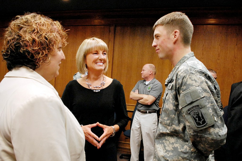 BREWER, ME -- OCTOBER 21, 2010 -- Susan Maiden chats (center) with her son Spc. Andrew Chic and Kate Schiessl (CQ), from the Maine National Guard Family Assistance Center, before an award ceremony on Thursday.  Jay Darling, president of Darling's Auto, was presented with the &quotAbove and Beyond&quot Award for his company's assistance, support, and compassion for employee Susan Maiden when her son was injured in May by two rocket-propelled grenades in Afghanistan.  SPC Chic is a member of the Bravo Company, Third Battalion of the 172nd Infantry Division with the Maine National Guard. LINDA COAN O'KRESIK