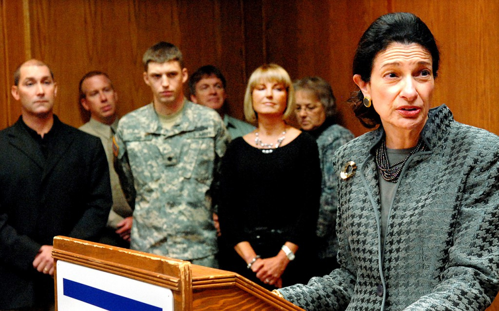 BREWER, ME -- OCTOBER 21, 2010 -- Senator Olympia Snowe speaks at the &quotAbove and Beyond&quot award presentation on Thursday that was given to Jay Darling of Darling's Auto for exemplary support of the Guard and Reserve. In background is Jay Darling (left), SPC Andrew Chic and his mother Susan Maiden (right).  Maiden is a Darling's employee and her son, SPC Chic, was injured in Afghanistan in May.  Darling's provided overwhelming support and compassion for Maiden and assisted her in traveling to and from Walter Reed Hospital in Washington DC where her son was recovering. LINDA COAN O'KRESIK