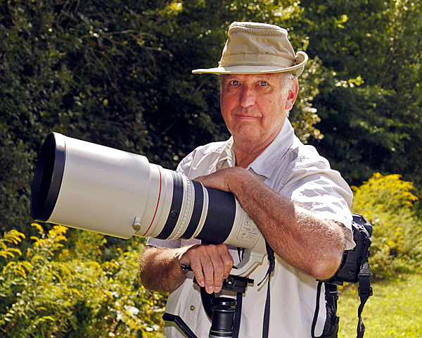 John Fast Photographer: John Fast, 68, of New London, Conn. stands with his Canon 1D Mark III digital camera with a Canon 600 mm f/4 Image Stabilized lens, which he uses to take photos of wildlife in Maine and other parts of the United States. Photo courtesy of John Fast