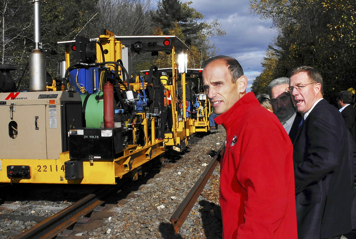 Pan Am Railways President David Fink, right, talks about the track replacement  his company is doing to extend the Downeaster line to Brunswick as Gov. John  Baldacci, left, and State Sen. Stanley Gerzofsky, D-Brunswick, center, listen.  (Bangor Daily News/Matt Wickenheiser)