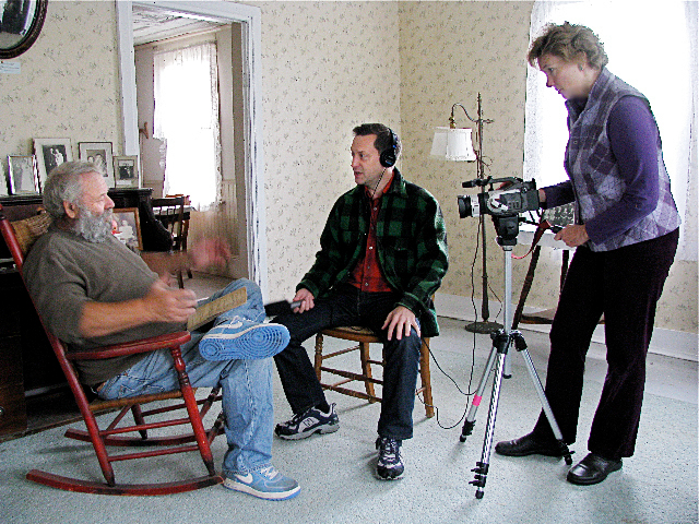 Jerry Nelson, left, is interviewed for ?Old Maine Swedish Farms? at the Ostlund House by Scandinavian Scholar, Dan Olson, center, while Brenda Jepson operates the camera. The half hour DVD was produced and directed by Jepson and captures the history of Maine?s Swedish Colony through the area?s Swedish speakers. The interviews are conducted in Swedish by Olson. Subtitles for the interviews are provided in English, while the  numerous dialects spoken by the last of the Swedish speakers are featured on the sound track. PHOTO COURTESY OF BRENDA JEPSON