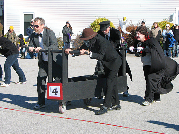 Members of the &quotBlack Magic&quot coffin race team, which won the Ghostport