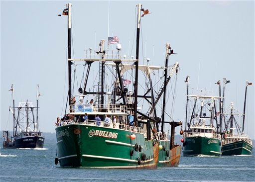 FILE - In this Aug. 26, 2010 file photo, fishing vessels form a flotilla in Vineyard Haven Harbor, in Vineyard Haven, Mass., to draw attention to fishing rules that some commercial fishermen say over-regulates their industry. Fishing advocates say federal regulations and natural challenges of the New England waters have led to underfishing _ a phenomenon that has struggling U.S. fishermen catching a fraction of what regulators say is a safe amount to take from various rebounded stock, leaving millions in potential revenue in the water. (AP Photo/Steven Senne, File)