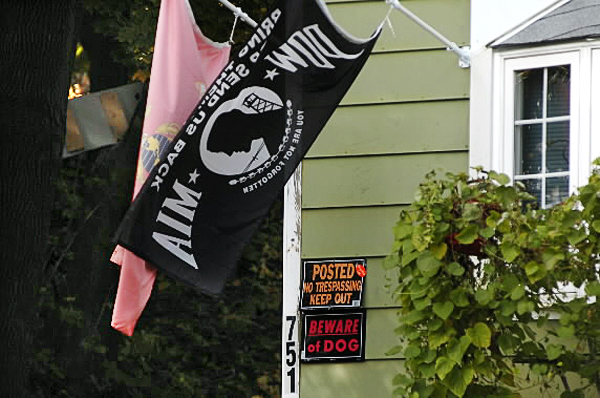 A U.S. Marine Corps flag, a P.O.W-M.I.A. flag, a no trespass sign and dog warning were seen at this 751 Main Street home in Bangor late Sunday morning, Oct. 24, 2010. Police closed down part of Main Street as well as part of  the neighborhood near the home during a standoff with a man inside the home Saturday evening, Oct. 23, 2010. The man was taken into custody shortly after midnight and transported to Eastern Maine Medical Center for evaluation. (Bangor Daily News/John Clarke Russ)