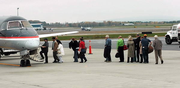 Passengers board a regional jet at Bangor International Airport on Tuesday, October 26, 2010. Bangor International Airport has been awarded a $500,000 federal grant that could help add service by United Airlines to one of its two major hubs in Chicago or Washington, D.C. or both. (Bangor Daily News/Kevin Bennett)