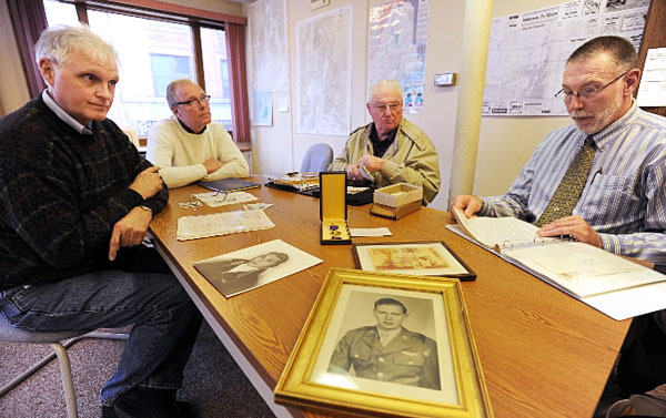 Thomas Birmingham of Windsor, John Birmingham of Old Town, Wilbur Birmingham of Rockland and Robert Birmingham of Durham, all nephews of deceased American flier, Robert J. Birmingham of WInterport, gather around a table at the Belfast office of the Bangor Daily News on Monday, October 25, 2010. The foursome had been looking for more information on their relative Robert Birmingham who was shot down over France in July of 1944. An article in the Weekly, a BDN published paper, got their attention with a story about a French association dedicated to recovering WW II artifacts and honoring fallen American soldiers from the WW II period. (Bangor Daily News/Kevin Bennett)