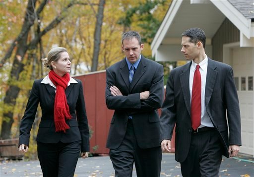 Prosecutors in the Steven Spader trial, from left, Lucy Carrillo, Peter Hinckley and Jeff Strelzin, leave the Cates home in Mont Vernon, N.H. after jurors viewed the murder scene Monday, Oct. 25, 2010. Steven Spader is facing murder and other charges in connection with the Oct. 4, 2009 house break-in and attacks that killed 42-year-old Kimberly Cates and severely wounded her daughter, Jaimie. (AP Photo/Don Himsel, Pool)