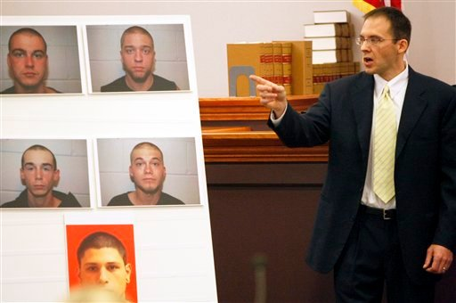 Assistant Attorney General Peter Hinckley points to Steven Spader's photograph, top-left, along with others allegedly involved in the murder of Kimberly Cates, during the prosecution's opening arguments on the first day of Spader's trial in Hillsborough Superior Court Tuesday, October 26, 2010, in Nashua, N.H. (AP Photo/Bob Hammerstrom, Pool)