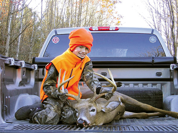 Parker Harriman, 10, of Hampden poses with the deer he shot while hunting with his stepfather, Brian Lachapelle, on Saturday's Youth Deer Day. The eight-point buck weighed 200.5 pounds. PHOTO COURTESY OF BRIAN LACHAPELLE