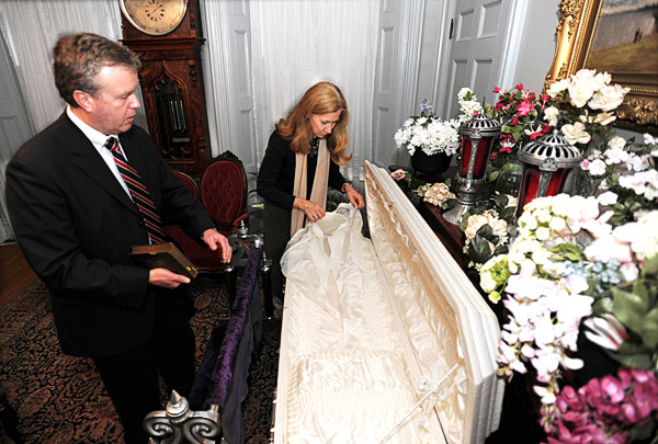 (BANGOR DAILY NEWS PHOTO BY KEVIN BENNETT)CAPTIONBrookings-Smith funeral director Jim Fernald and Bangor Museum and Center for History curator Dana Lippett inspect an antique child's casket on display at the Thomas Hill house in Bangor on Tuesday, October 26, 2010. The casket and other assorted funeral related items are part of this weekend's program featuring a talk about Victorian-era embalming techniques and funeral traditions. (Bangor Daily News/Kevin Bennett)