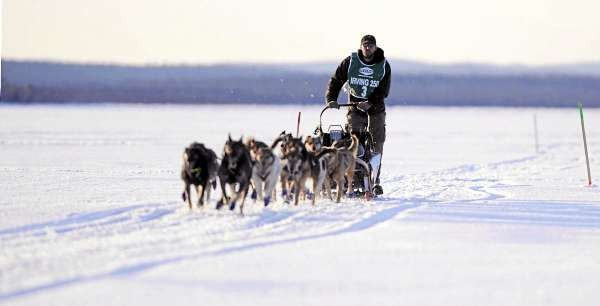 Matt Carstens of Whitefield, N.H., and his dogs approach the Portage Lake checkpoint Saturday during the Can-Am Crown 250 sled dog race. Carstens won his second straight title, finishing in 26 hours, 3 minutes, 30 seconds.  (BANGOR DAILY NEWS PHOTOB Y JOHN CLARKE RUSS)  CAPTION  Matt Carstens of Whitefield, New Hampshire approaches the Portage Lake checkpoint of the Can-Am Crown 250 in Portage Lake, Maine shortly before sundown Saturday, March 6, 2010. Carstens won the Can-Am Crown 250 in 2009 and 2006 . (Bangor Daily News/John Clarke Russ) **MANDATORY CREDIT**