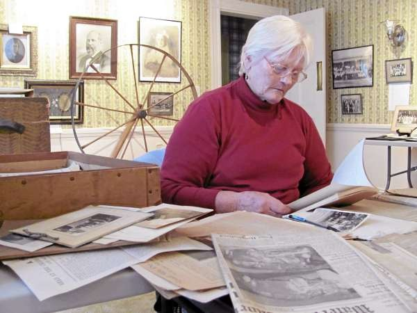 Joyce Penich, a volunteer at the Old Canada Road Historical Society, sorts through stacks of decades-old newspapers, pamphlets and books in this Oct. 29, 2010 photograph. Cataloging the society's artifacts is one of its major challenges, now that the society has opened its headquarters at 16 Sidney Street in Bingham. (Bangor Daily News/Christopher Cousins)