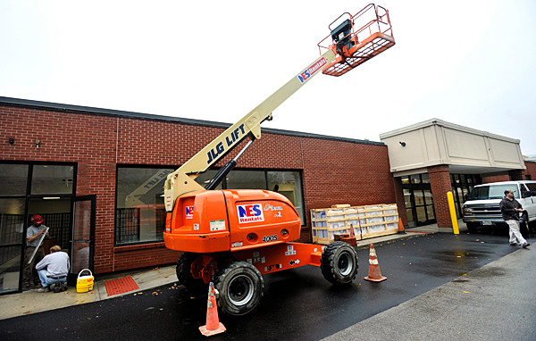 Contractors were busy Wednesday, Oct. 27 putting the finishing touches on Bangor's soon-to-open post office. The post office is at the site of the former Third District Court, on the corner of Hammond and Franklin Streets and is set to open Monday, November 1. The interim post office at the Broadway Shopping Center is set to close at 1 p.m Saturday, Oct. 30 to accomodate the weekend move to the new site. (Bangor Daily News/John Clarke Russ)
