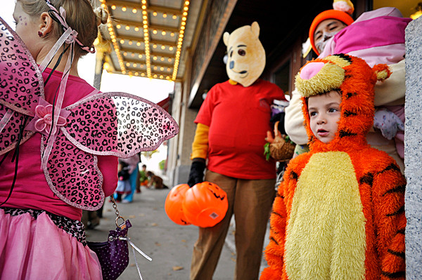 Dressed as &quotTigger&quot,  Eli Hoshide, 5, of Bangor, his mother Kristie Miner (cq) (costumed as &quotWinnie The Pooh&quot), his father Aaron Hoshide and his little brother Isaac Hoshide (costumed as &quotPiglet&quot,in dad's arms) joined others at Penobscot Theatre for Bangor's downtown Halloween Parade late Saturday afternoon. (Bangor Daily News/John Clarke Russ)