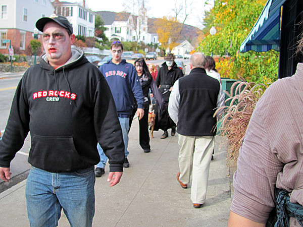 A pack of about a dozen zombies lurching through Camden's downtown on Saturday, Oct. 30, 2010 attracted some curious glances. The attack of the undead was organized as a &quotflash mob&quot event, which in big cities are known to stage hundreds or thousands of participants who all participate in some form of performance art or prank.  BANGOR DAILY NEWS PHOTO BY CHRISTOPHER COUSINS