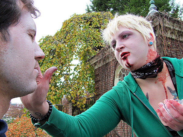 Whitney Carpentier of Camden, one of the organizers of a flash mob zombie attack on downtown Camden Saturday, Oct. 30, 2010, applies make-up to one of the participants. A flash mob is a surprise event involving numerous people who in most cases connect through social media web sites such as Facebook and Twitter. BANGOR DAILY NEWS PHOTO BY CHRISTOPHER COUSINS