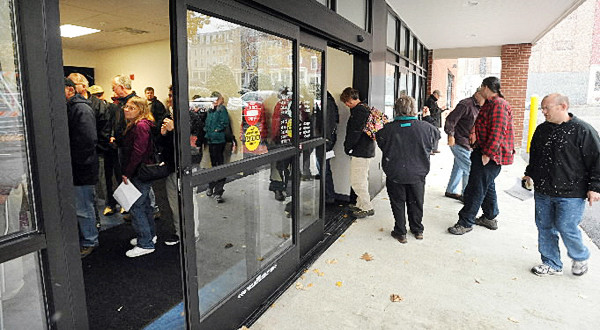 People stand in line to pick up their keys to the Post Office Boxes at the new location of the Bangor Post Office Sunday morning. (Bangor Daily News/Gabor Degre)