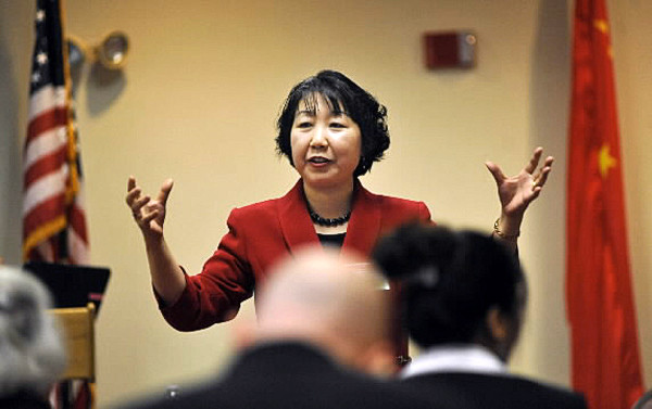 Jing Zhang, director of the Bangor Chinese School, discusses foreign language teaching techniques during the the Maine Chinese Language Conference at the Dyke Center of Family Business at Husson University in Bangor Friday. (Bangor Daily News/John Clarke Russ)