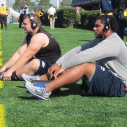 University of Maine defensive linemen Kevin Phanor (right) and Ryan Nani loosen up prior to Saturday's CAA football game against Delaware in Newark, Del.