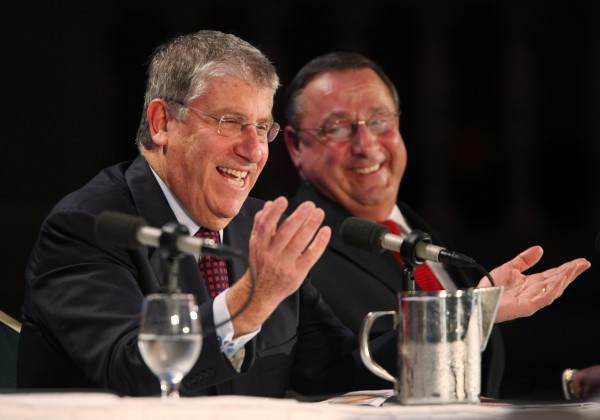 Gubernatorial candidates independent Eliot Cutler, left, laughs with Republican Paul LePage, right, during a debate hosted by the Maine State Chamber of Commerce Wednesday Oct. 20, 2010 in Portland. (AP Photo/Joel Page)
