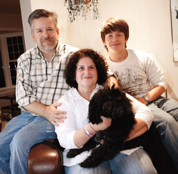 Lori Whyte , who had a mysterious headache which doctors had trouble diagnosing, poses in her home in Sterling,Va on Sept.309,2010  Doctors  now believe she has Chiari 1 malformation , a structural defect of the skull. Lori poses with her husband,Stephen, son,Alex, and dog, Kipper.