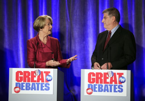 Democratic gubernatorial candidate Elizabeth &quotLibby&quot Mitchell, left, speaks to independent candidate Eliot Cutler during a debate on Saturday in Portland.