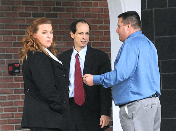 Lorraine and Roger Morin talk to their attorney, A.J. Greif, center, outside the Federal Court House in Bangor after the first day of their trial in Federal Court.  The Morins sued Eastern Maine Medical Center after Lorraine was sent home from the hospital to deliver her dead son.  She told the court Monday that she has nightmares about delivering the dad fetus in the bathroom of her Millinocket home.