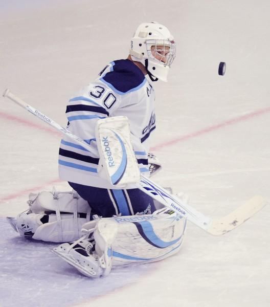 Maine's goalie Dan Sullivan (30) makes a first-period save against North Dakota Saturday, Oct. 23, 2010.