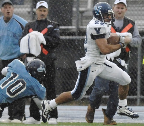 Villanova running back Angelo Babbaro (22) races out of the hands of Maine linebacker Donte Dennis (10) and down the sideline for a  touchdown in the second half of their NCAA college football game in Orono, Maine, Saturday, Oct. 16, 2010. (AP Photo/Michael C. York)