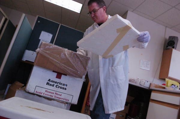 Tim Churchill of Hermon, a donor center assistant at the Bangor Donor Center for the American Red Cross, returns a styrofoam a box of blood donations at the center August 24, 2010.