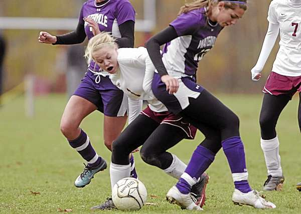 Bangor senior Kim Jordan squeezes through Waterville's Jordan Pellerin (left) and Emily Karter to gain control of the ball during their Eastern Maine Class A semifinal Saturday. Jordan and the Rams play Brunswick for the regional championship on Wednesday. (BDN Photo by John Clarke Russ)