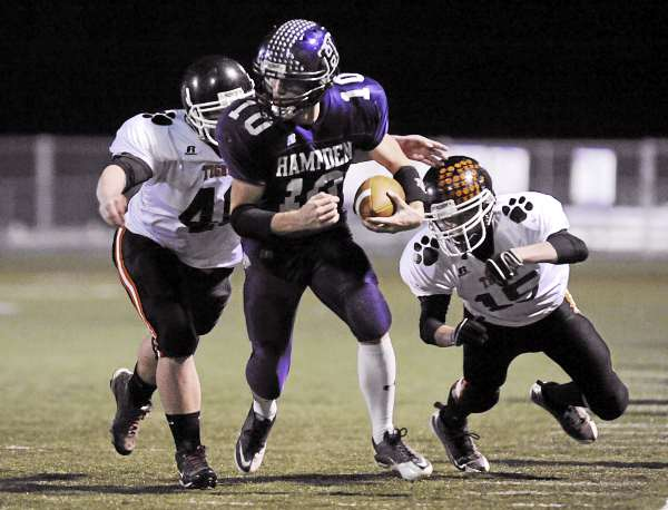Hampden's Jon Haws (10) gets tackled out of bounds by Gardiner's Seth Wing (40) and Justin Lovely (15) in the first half of their game in Hampden, Friday, Nov. 5, 2010. Gardiner won 28-25. Bangor Daily News/Michael C. York