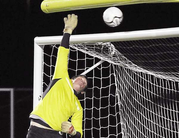 Bangor goalkeeper Jessie Perkins survived a late flurry of shots from Portland players such as this one that cleared the crossbar in the final minutes of the second half in Falmouth, Saturday, Nov. 6, 2010. Bangor beat Portland 3-2 for the Class A state title. Bangor Daily News/Michael C. York