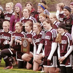 The Caribou High School girls soccer team shows off the runner-up trophy after dropping a 1-0 decision to Falmouth in the Class B state championship game in Falmouth. Bangor Daily News/Michael C. York