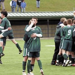 Members of the Ft. Kent boys soccer team celebrate their victory over NYA to win the Class C boys championship on Saturday, November 6, 2010 at Hampden. Fort Kent won 2-1. (Bangor Daily News/Kevin Bennett)