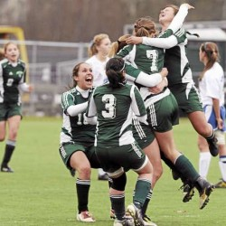 Members of the Fort Kent girls soccer team celebrates a goal by Alexis Desjardins (7) during the second half of Saturday's Class C soccer state championship game in Hampden. Sacopee Valley of South Hiram won 2-1 in overtime.