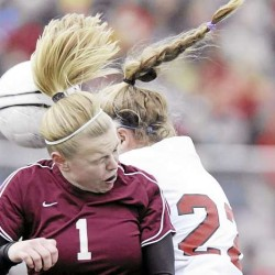Bangor's Kim Jordan (1) collides with Scarborough's Tori Armishaw (22) while going for a header in the first half of Saturday's Class A girls soccer state championship game in Falmouth. The Red Storm won 3-0. (Bangor Daily News/Michael C. York)