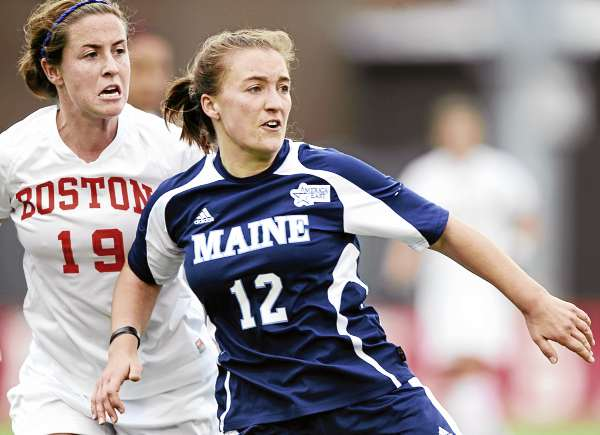 Kelsey Wilson of the University of Maine has position on Boston University's Shauna Kelleher during Saturday's America East women's soccer championship game at Nickerson Field in Boston University. The Terriers shut out the Black Bears 4-0..