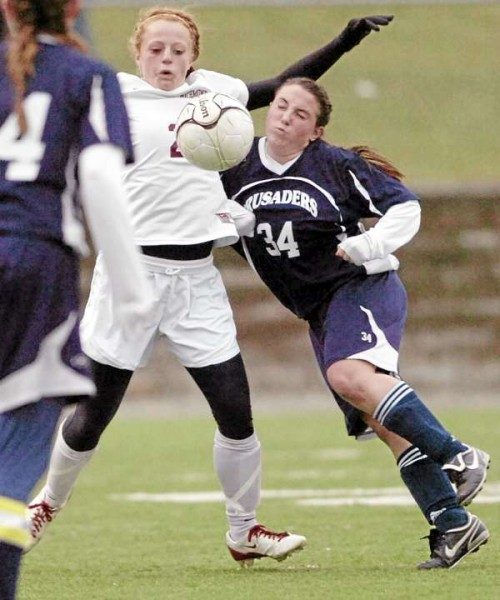 Van Buren District High School's Kayla Durette (right) pressures Richmond's Noel Acord as Acord blocks a pass during the girls Class D state soccer title game in Hampden Saturday afternoon. Richmond won 1-0.