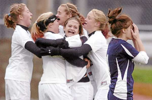 After scoring the winning goal, Richmond High School forward Danica Hurley (center) is all smiles as her teammates congratulate her as Van Buren defender Brittany Duprey (right) reacts during the Class D state soccer final in Hampden Saturday, Nov. 6. The MPA's soccer committee will be surveying schools about how best to host the state finals, with the focus on two issues. (Bangor Daily News Photo by John Clarke Russ)