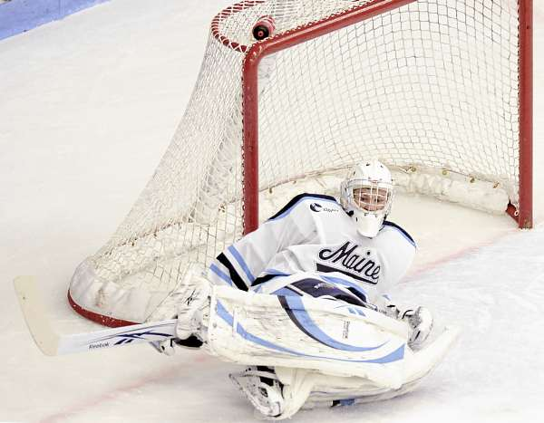 Maine goalie Dan Sullivan (30) loses his balance and falls in front of the net during a Northeastern power play in the first period of their game in Orono, Friday, Nov. 12, 2010. Maine won 4-2. Bangor Daily News/Michael C. York
