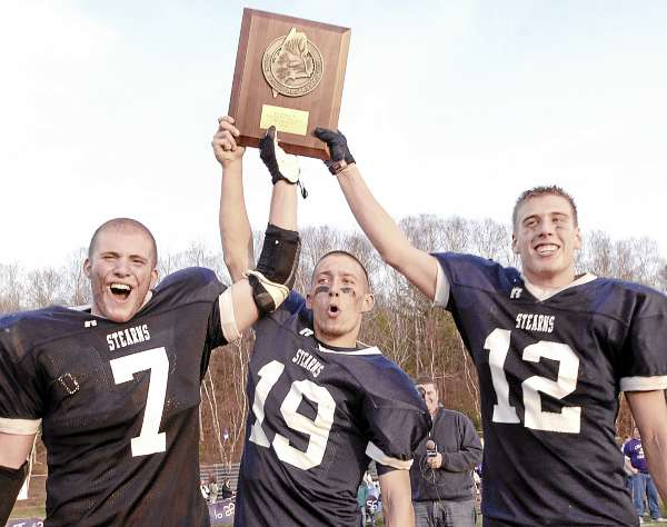 Stearns Captains Charlie Tapley (7), Jared McGreevy (19), and Billy Eurich (12) show off the Eastern Maine Class C championship trophy in Millinocket, Maine Saturday, Nov. 13, 2010.  Bangor Daily News/Michael C. York