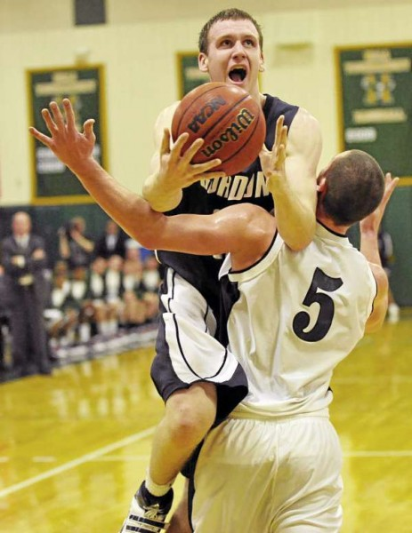 Husson University's Eric Modica (5) holds back Gordon College's Greg Walker as Walker tried to put up a shot in the second half of their game at Newman Gym Tuesday night. (Bangor Daily News/John Clarke Russ)