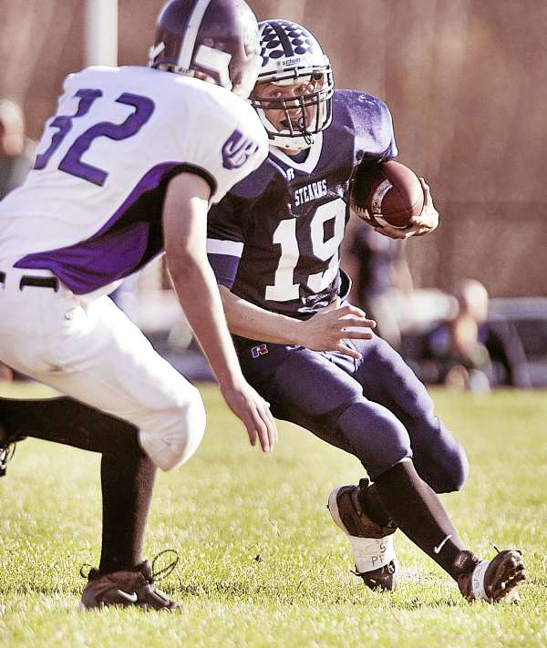 Stearns' Jared McGreevy runs for yardage against John Bapst in the Eastern Maine Class C final in Millinocket on Saturday, Nov. 13, 2010. Stearns won 20-7 and advanced to the state final against Yarmouth. Bangor Daily News/Michael C. York