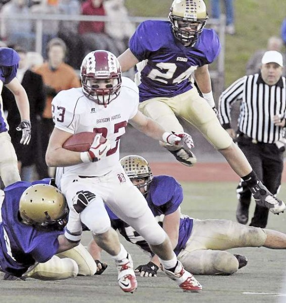 Bangor's Josiah Hartley tries to get some yardage in the second half of the state Class A football championship game Saturday against Cheverus at Fitzpatrick Stadium in Portland. The Stags of Portland won 46-8.