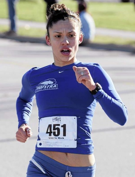 Jen Dagan of Bangor is the first female to cross the finish line Sunday during the Brewer Turkey Trot. Dagan posted a time of 17 minutes, 40 seconds.