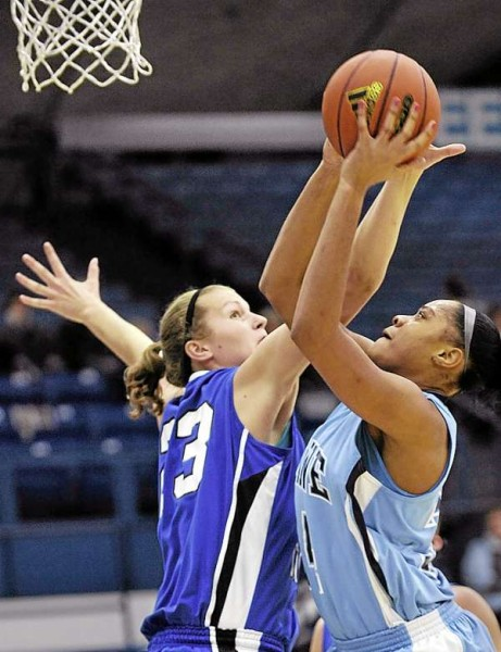 The University of Maine's Corinne Wellington (right) puts up a shot against Central Connecticut defender Kirsten Daamen during the first half of Tuesday night's game at Alfond Arena in Orono. Central Connecticut won 62-57.